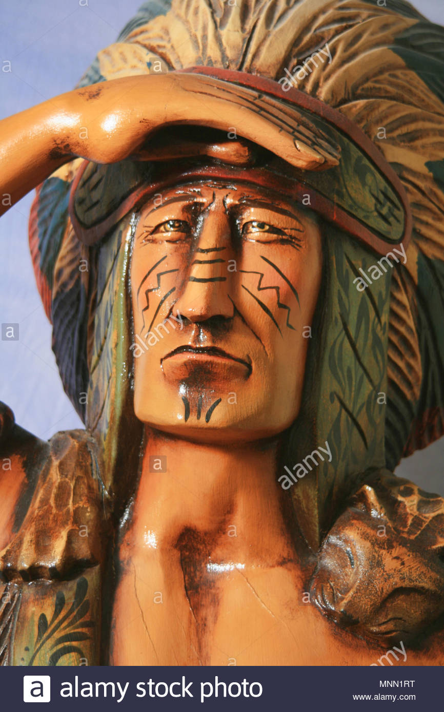 A large wooden cigar store Indian. - Stock Image