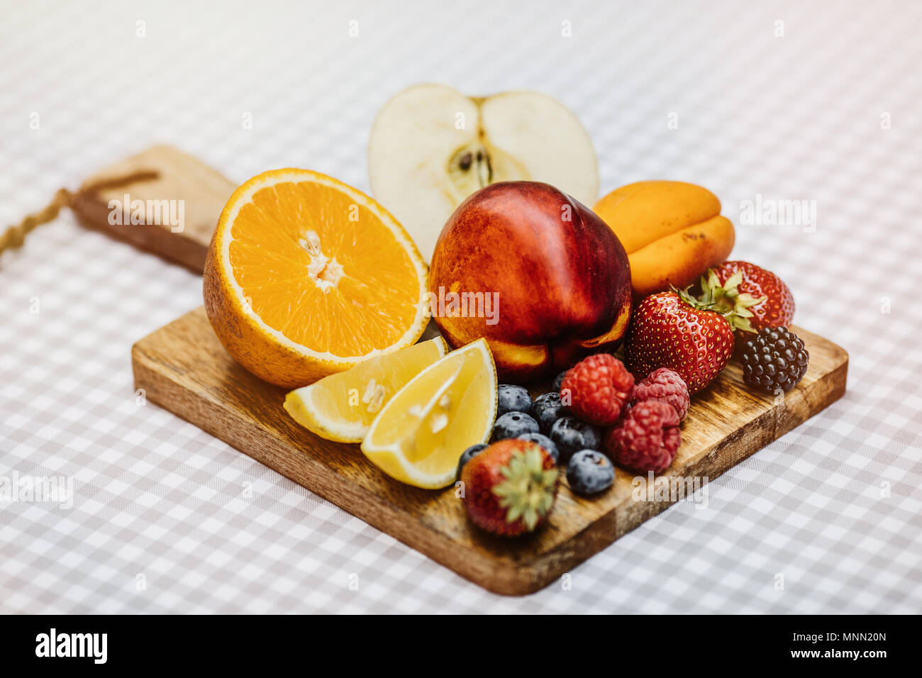 Traditional summer drink sangria - red, pink and white. With champagne, pink and red wine, strawberries, oranges, lemon, green apple and grapefruit. copy space for text. - Stock Image