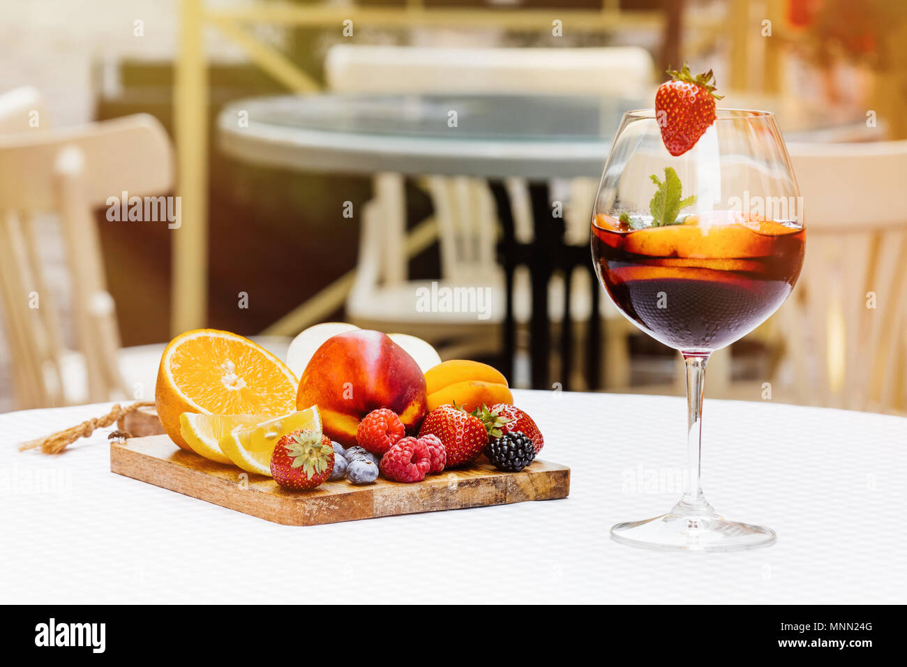 Traditional summer drink sangria - red, pink and white. With champagne, pink and red wine, strawberries, oranges, lemon, green apple and grapefruit. copy space for text. Stock Photo