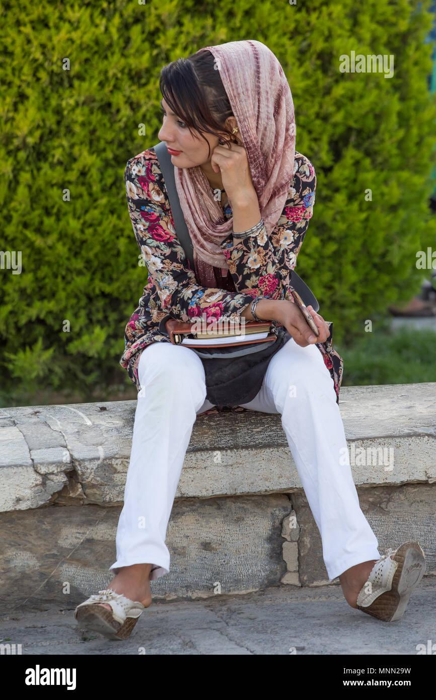Woman painting in Naqsh-e Jahan Square in Isfahan, Iran. Stock Photo