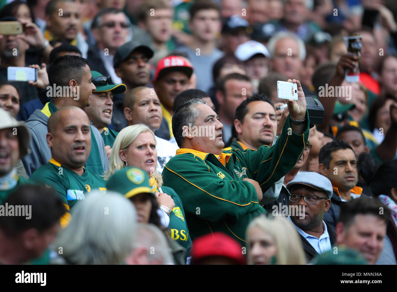 CAPE TOWN, SOUTH AFRICA - Saturday 7 October 2017,  a spectator sings and films the singing of the national anthem during the Castle Lager Rugby Champ - Stock Image