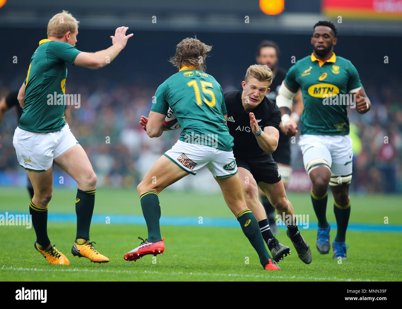 CAPE TOWN, SOUTH AFRICA - Saturday 7 October 2017,  Damian McKenzie of New Zealand tackles Andries Coetzee  of South Africa during the Castle Lager Ru - Stock Image