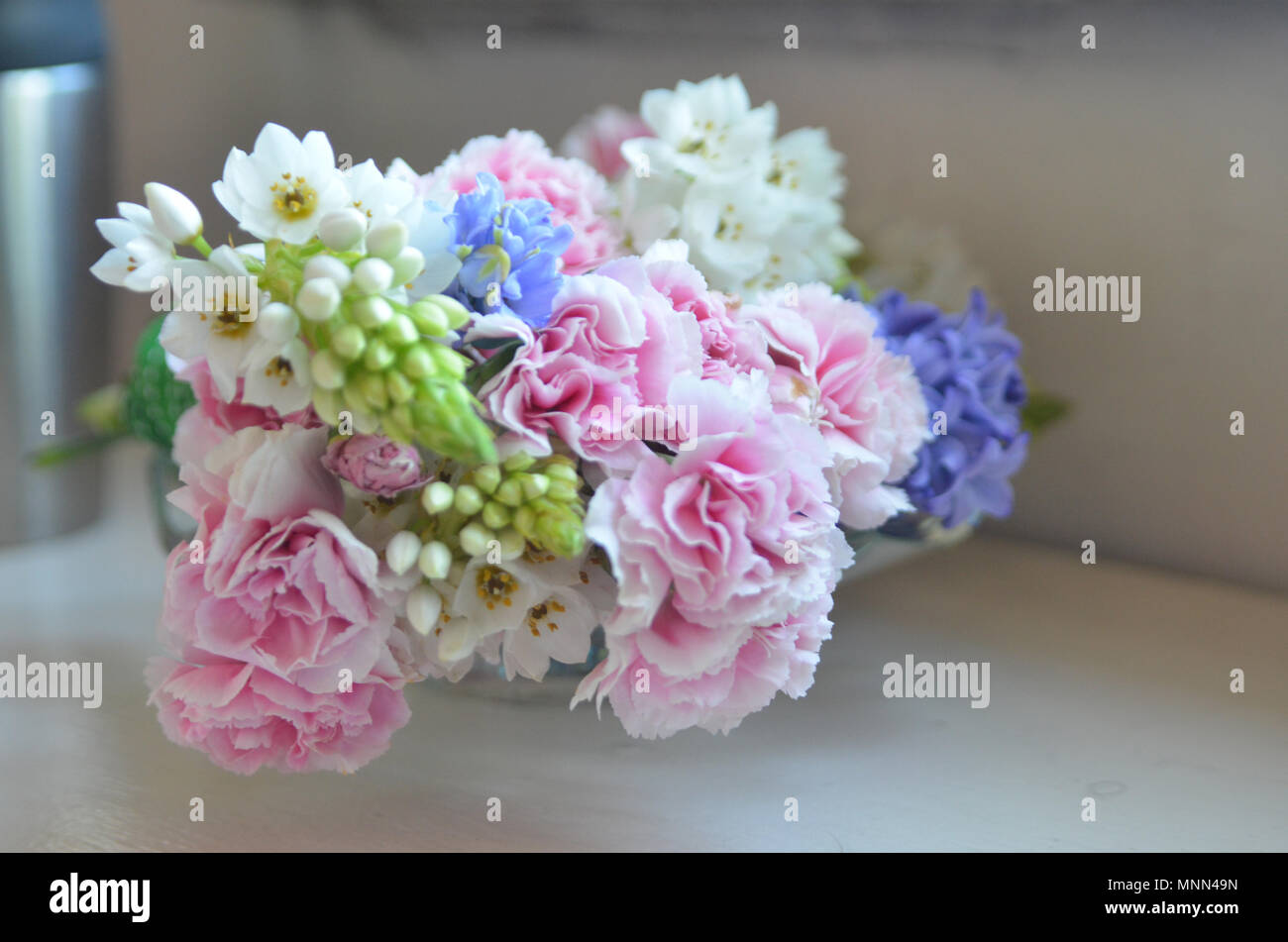 Pink White And Pruple Wedding Flowers Lit By Soft Natural Light