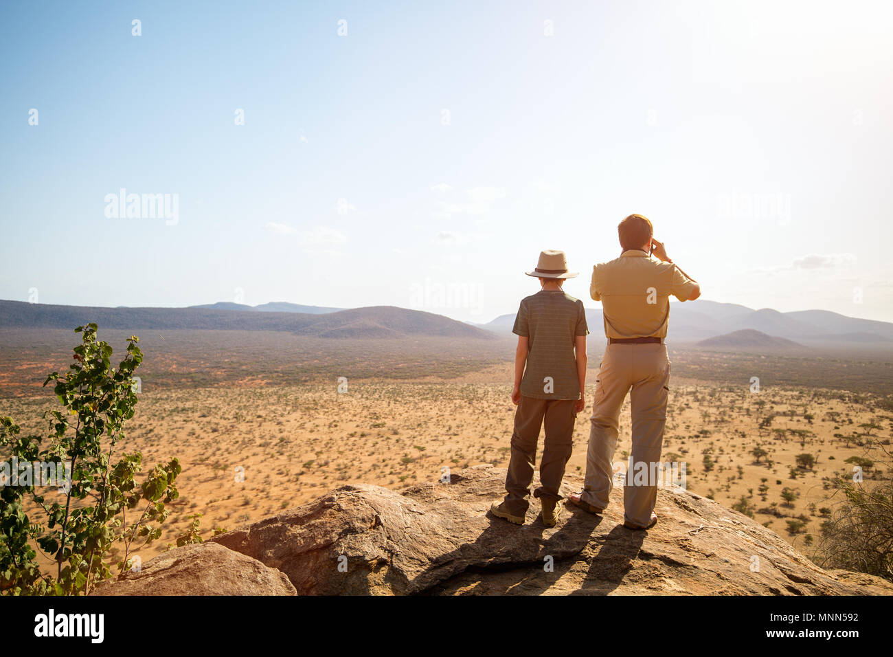 Family of father and child on African safari vacation enjoying view over Samburu Kenya - Stock Image