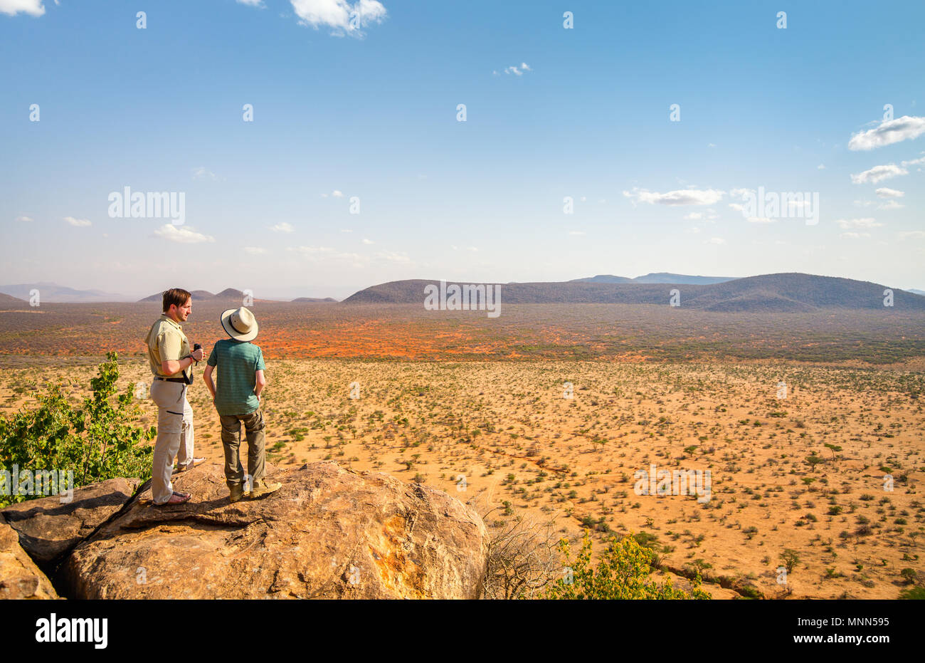Family of father and child on African safari vacation enjoying view over Samburu Kenya - Stock Image