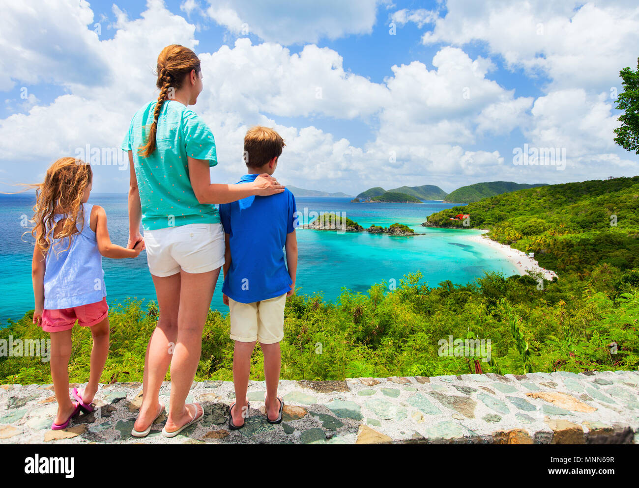 Family of mother and kids enjoying aerial view of picturesque Trunk bay on St John island Stock Photo