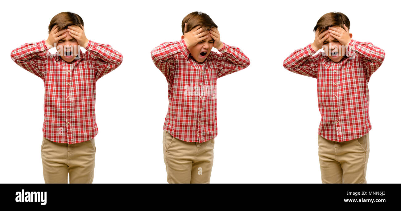 Handsome toddler child with green eyes stressful keeping hands on head, terrified in panic, shouting - Stock Image