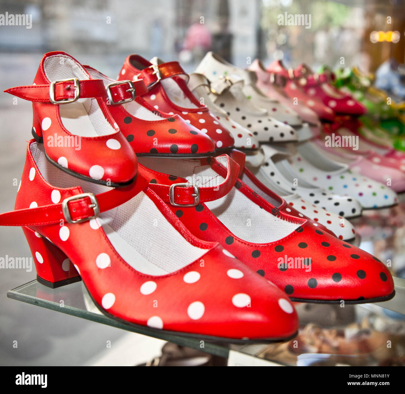 Flamenco dancing shoes or gypsy shoes with polka dot spots in shop market, Seville, Spain. - Stock Image