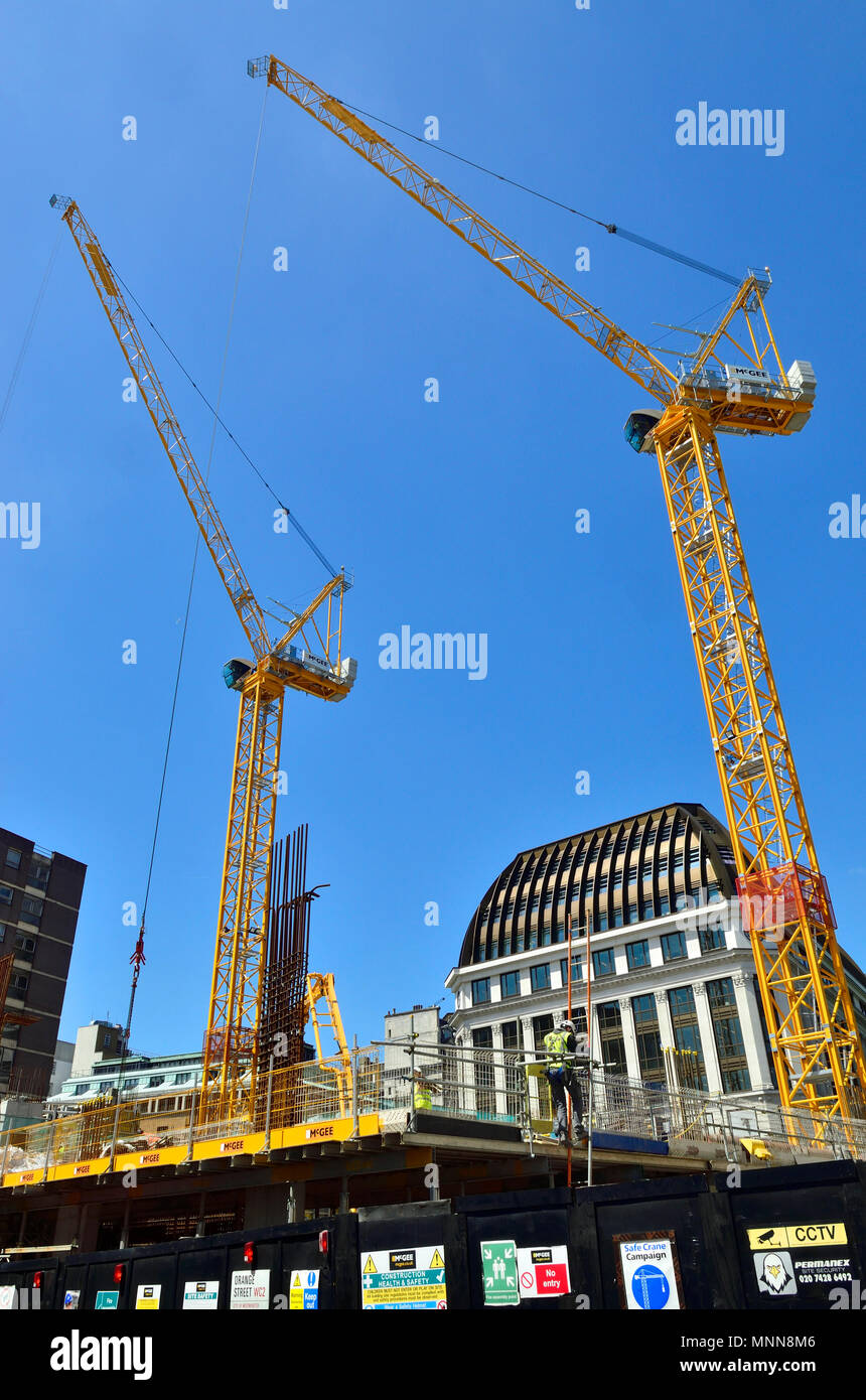 Construction work in Leicester Square, London, England, UK. Cranes abover the LSQLondon building (offices and retail) - Stock Image