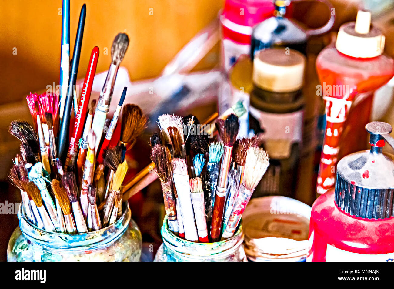 Many different brushes and colours; viele verschiedene Pinsel mit Farbe Stock Photo