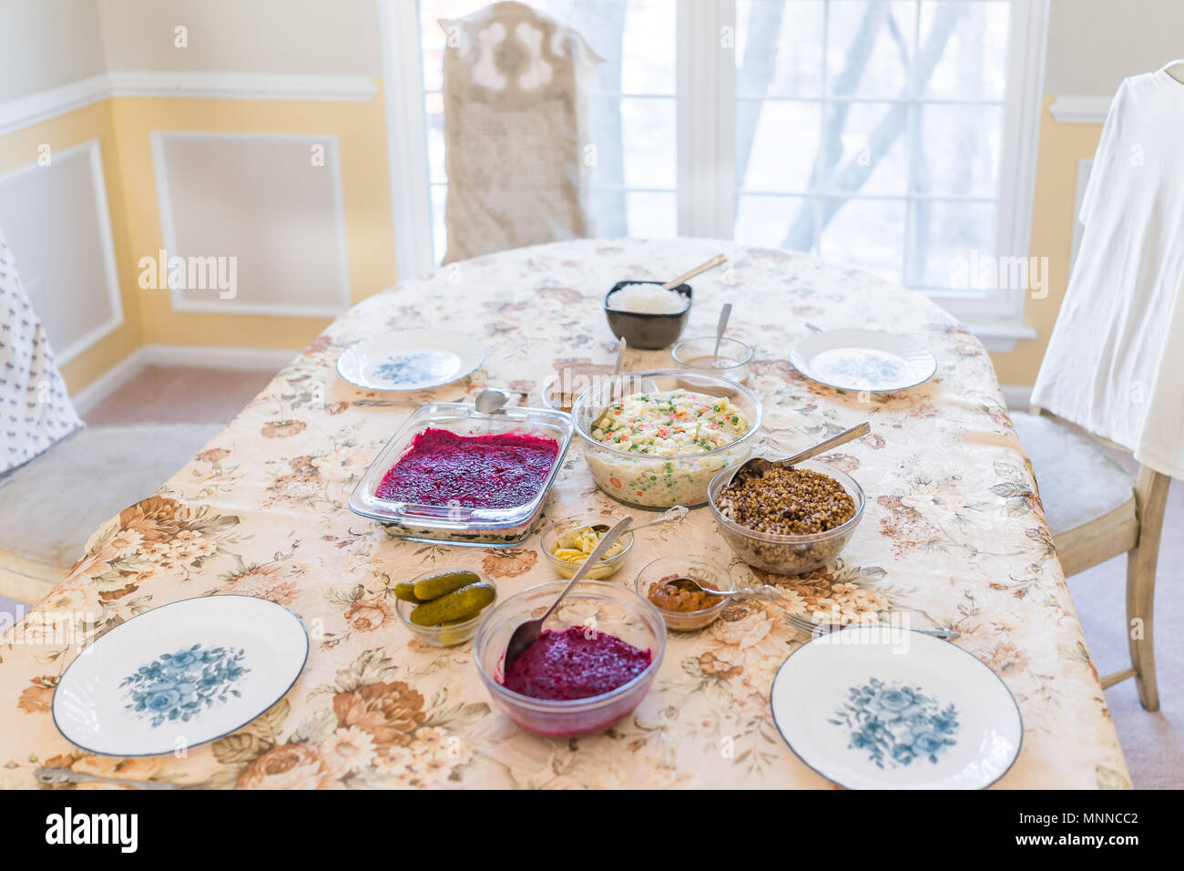 Simple traditional Slavic Russian Ukrainian Orthodox Christmas Eve dinner supper with 12 dishes, celebrated on January 7th, such as Kutia, beet salads - Stock Image