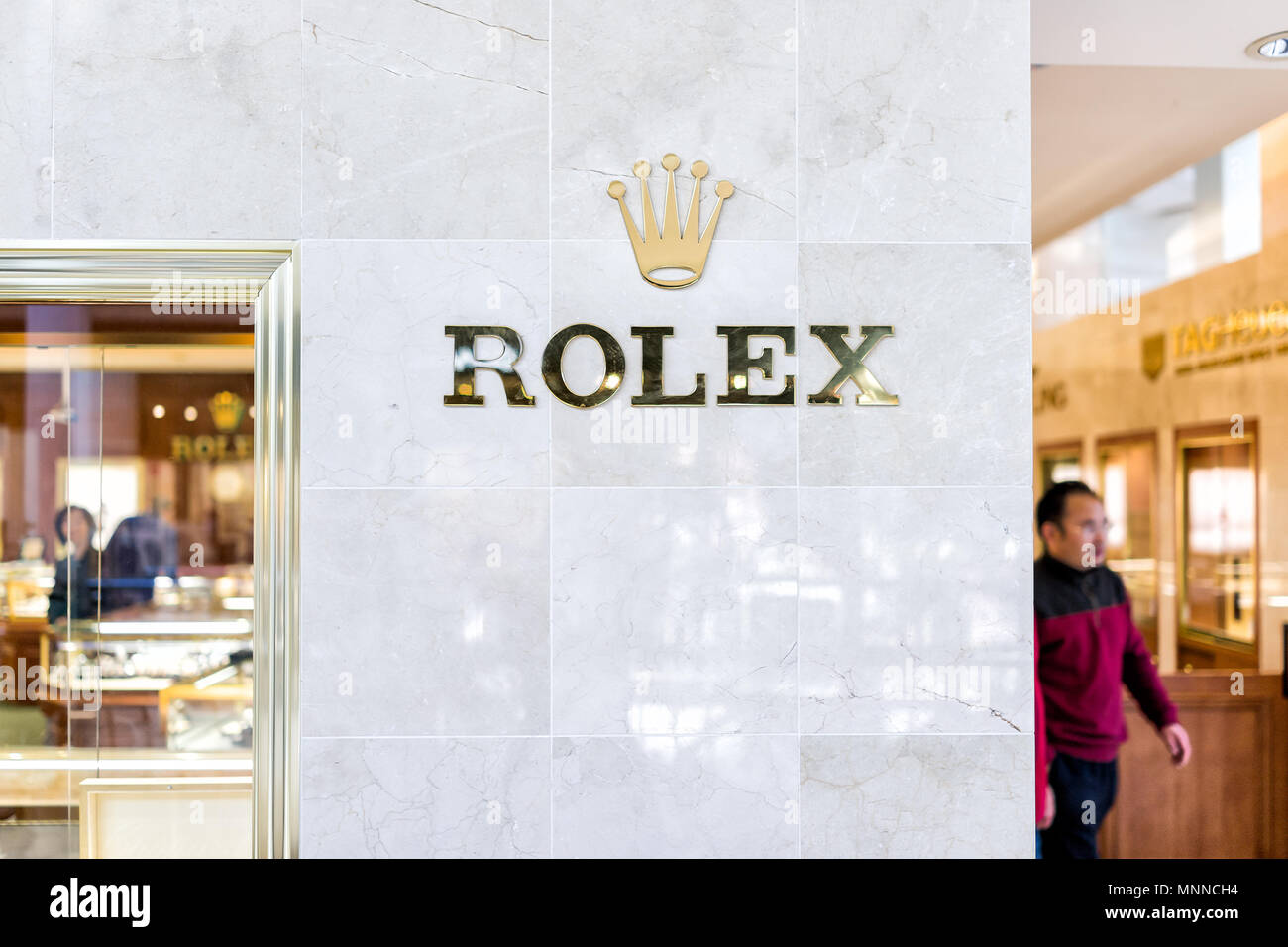 Tysons, USA - January 26, 2018: Rolex closeup store sign entrance watch time shopping in Tyson's Corner Mall in Fairfax, Virginia by Mclean - Stock Image