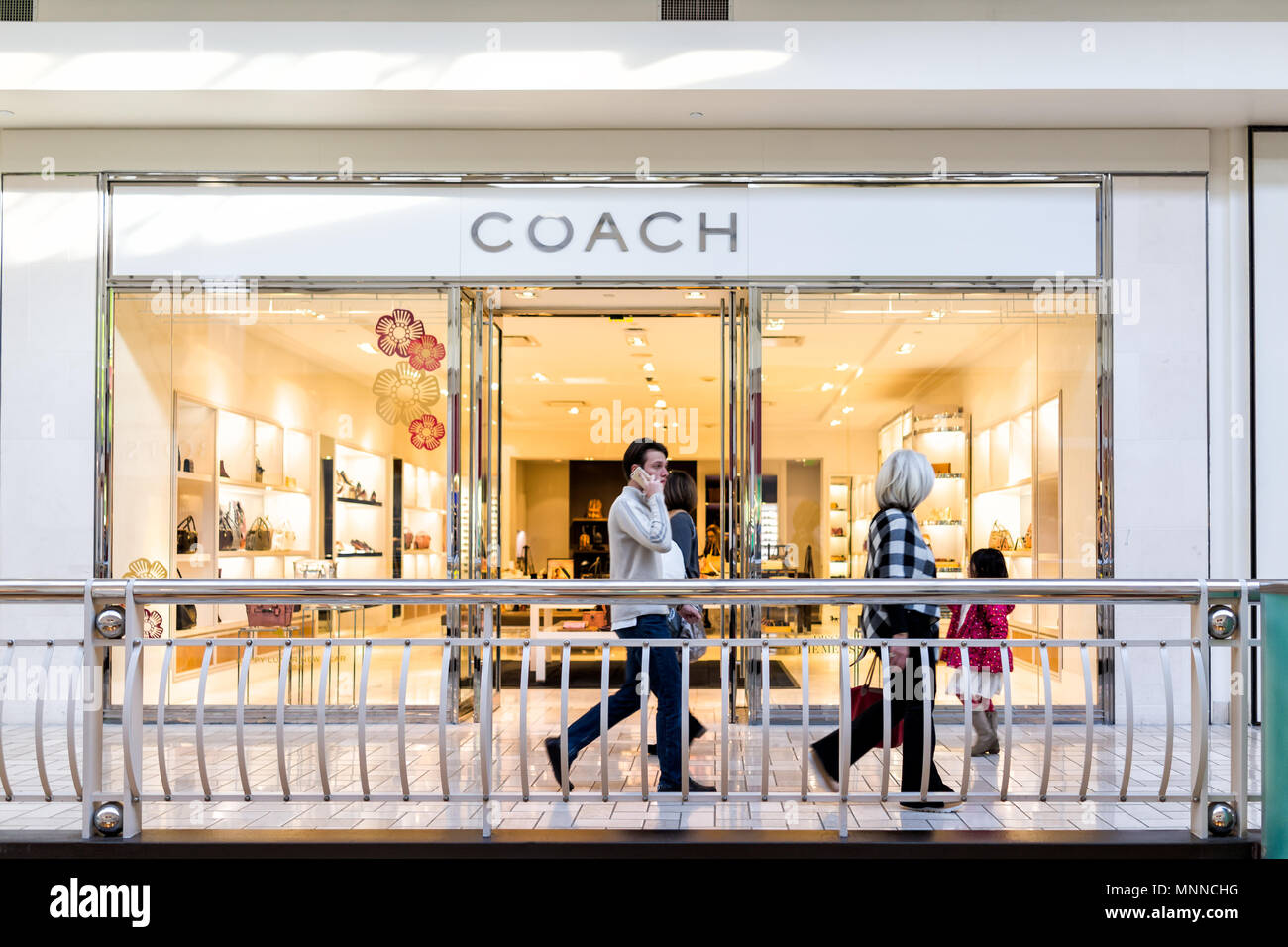 Tysons, USA - January 26, 2018: Coach store sign entrance shop purses display in Tyson's Corner Mall in Fairfax, Virginia by Mclean - Stock Image