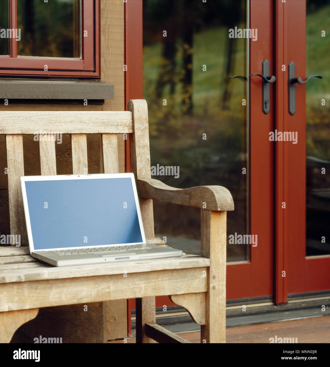 Deck Screen Desk Office Furniture For Laptop Computer With Blank Screen On Wooden Bench Deck Or Patio Of Upscale Home Resort Mobile Office Working Using Wireless Technology Outdoors