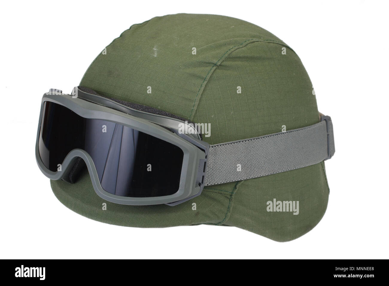 063dc259da4f33 kevlar helmet with a camouflage cover and protective goggles isolated on white  background