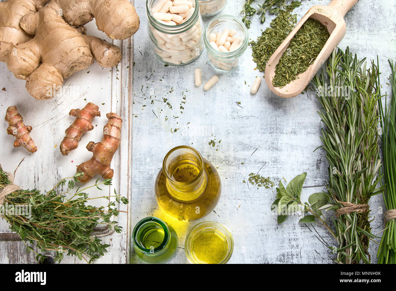 Healing herbs, essential oils and homeopathic pills. Homeopathy and Alternative Medicine - Stock Image