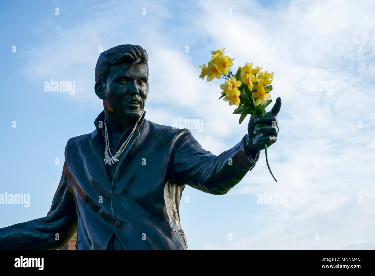 Close up of the Billy Fury statue holding a bunch of daffodils at the Albert Dock Liverpool UK - Stock Image