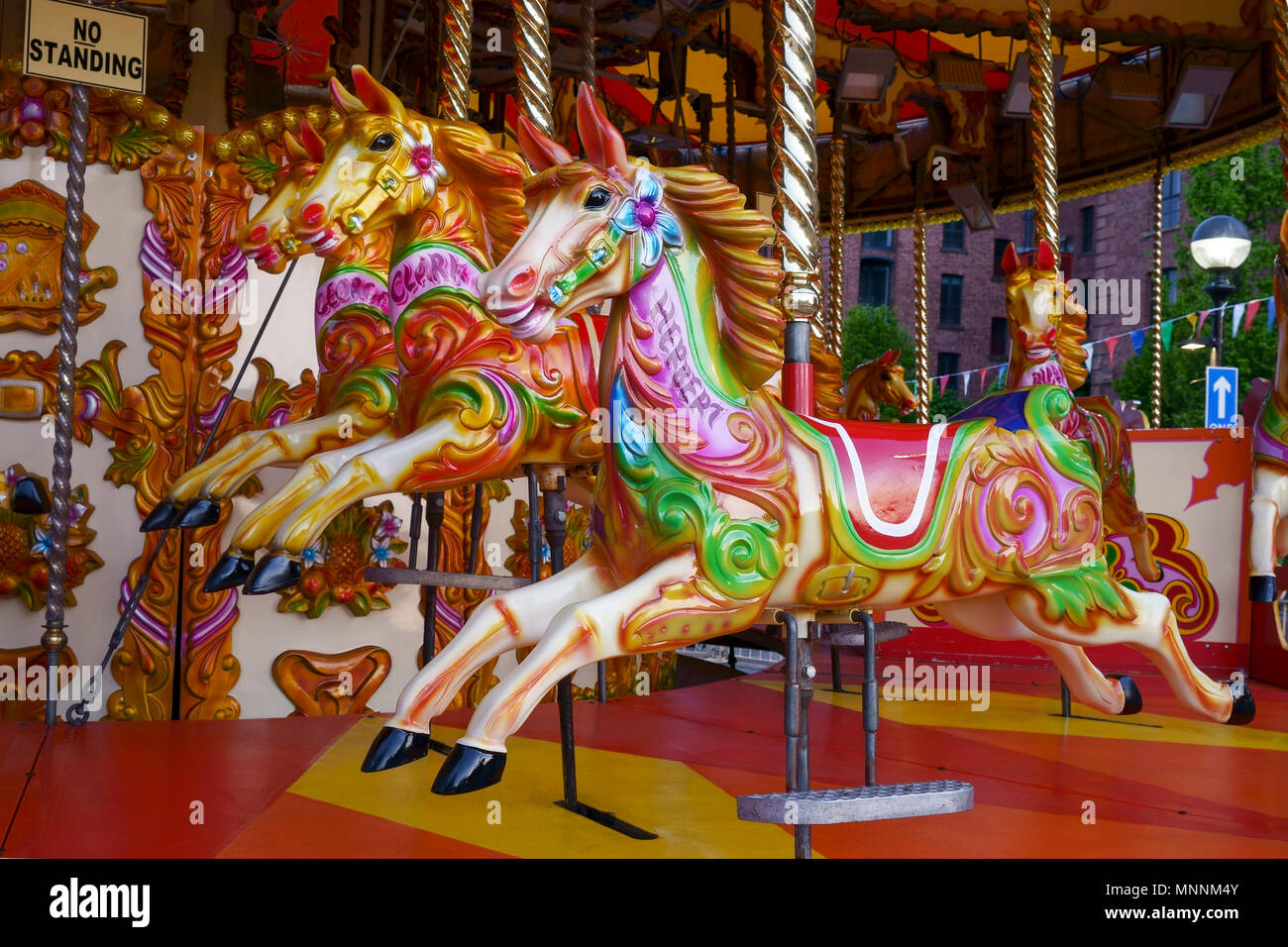 Horses on a fairground carousel ride - Stock Image