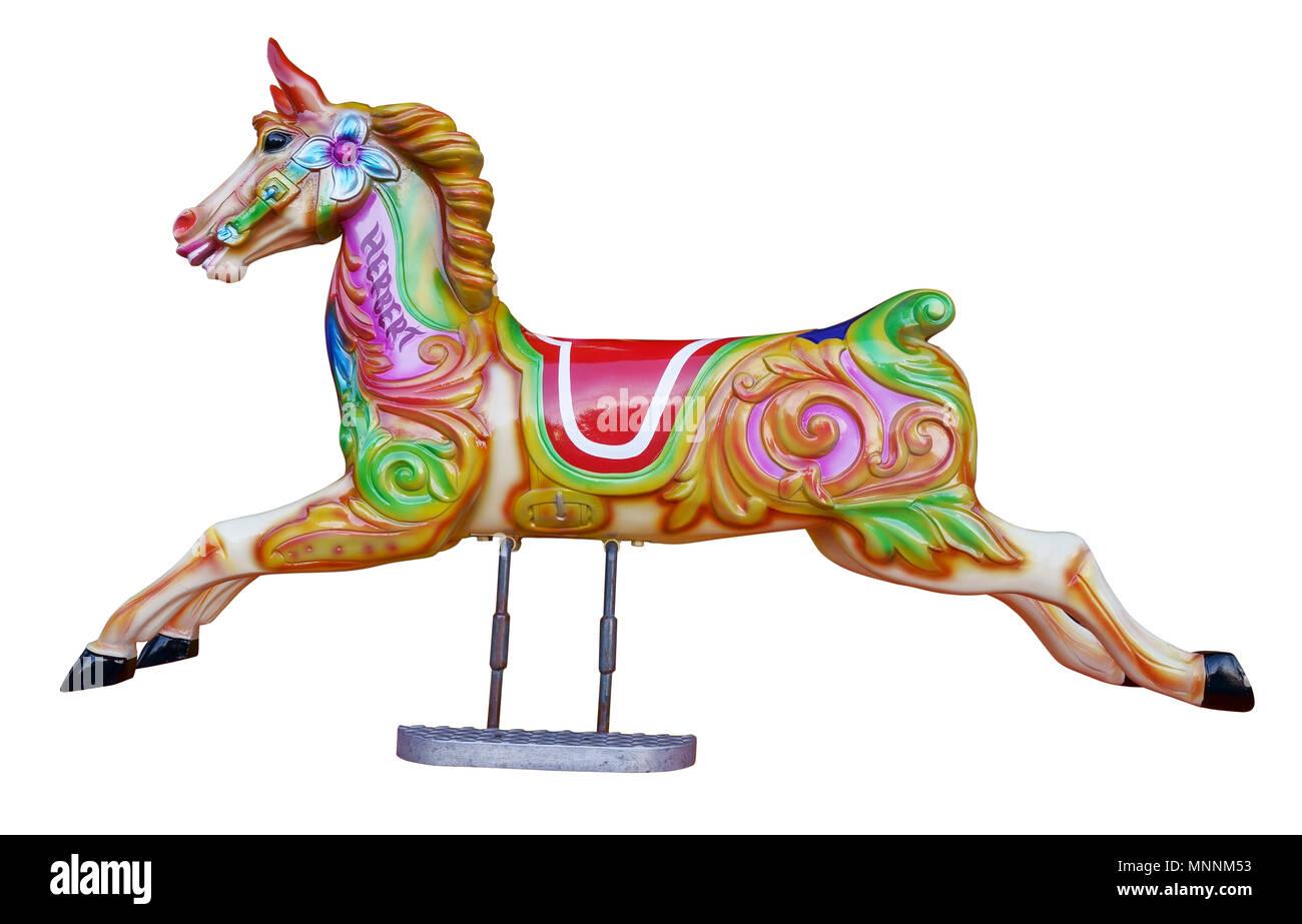 Horses on a fairground carousel ride Stock Photo