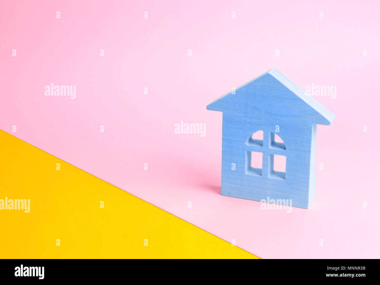 Blue wooden house on a pink background in pop style. The concept of ...