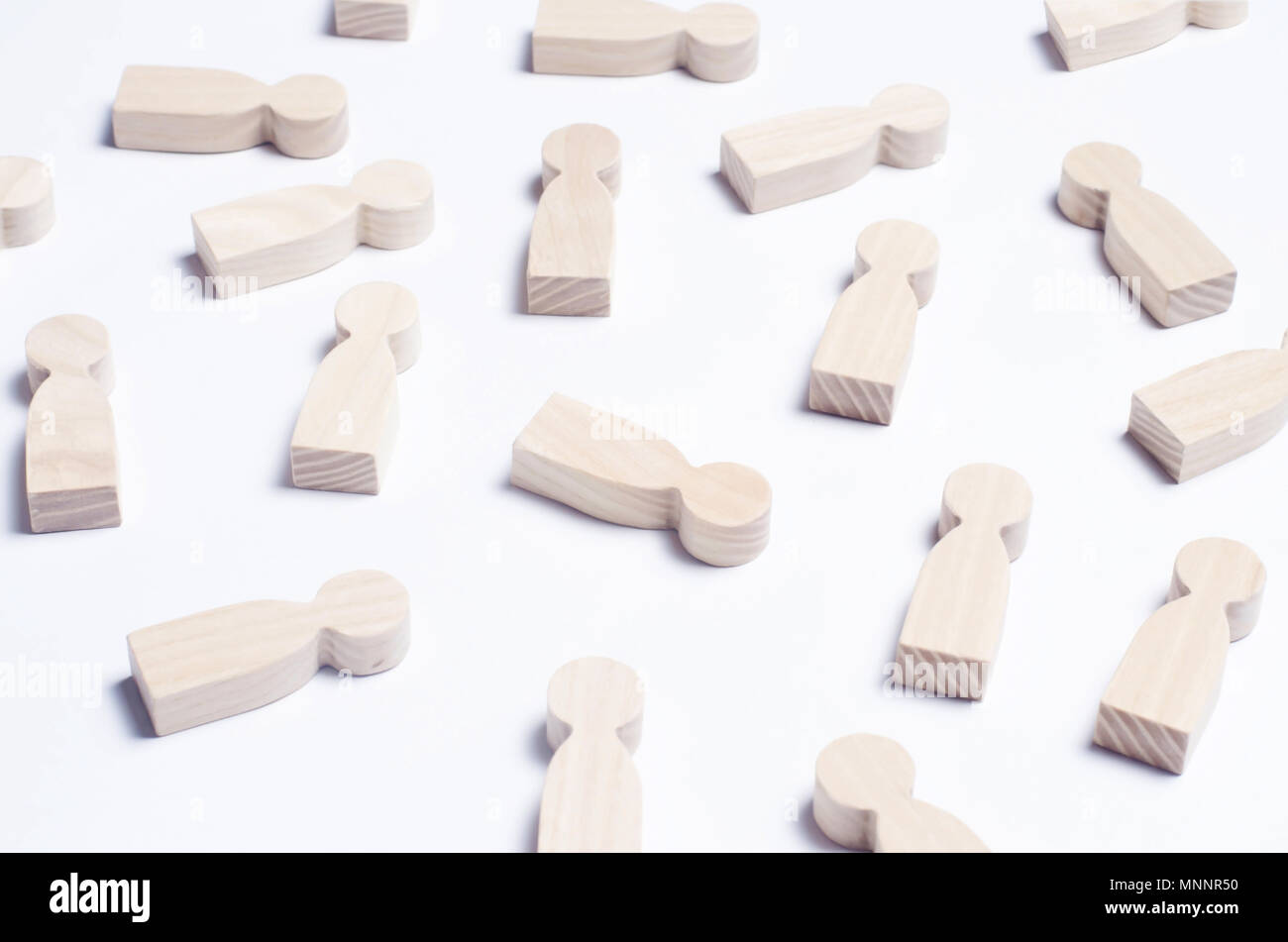 Wooden figures of people on a white background. The concept of society, collective, company, family, neighbors. A crowd of people at a meeting, rally. - Stock Image