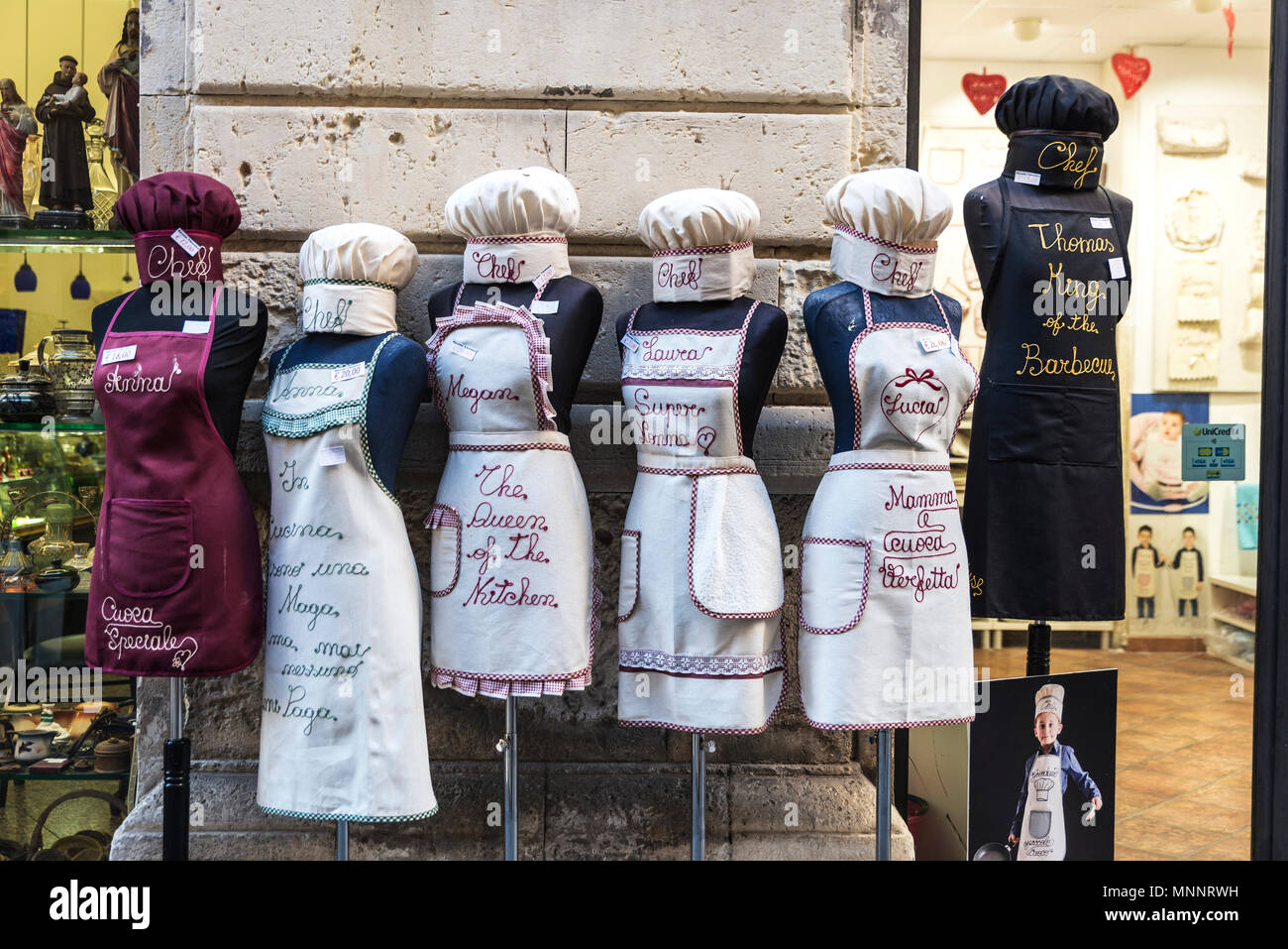 Siracusa, Italy - August 17, 2017: Aprons shop of Ricami Veronica in the old town of the historic city of Siracusa in Sicily, Italy - Stock Image