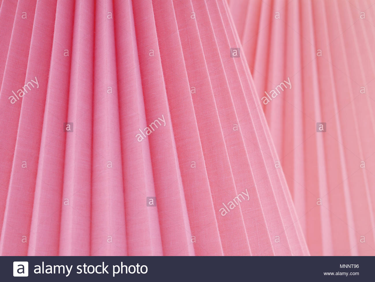 Artistic Abstract with Folded Rose Pink Fabric at Slanted Parallel Angles. A design background with room or space for copy, text, words, or a Wall Pic - Stock Image