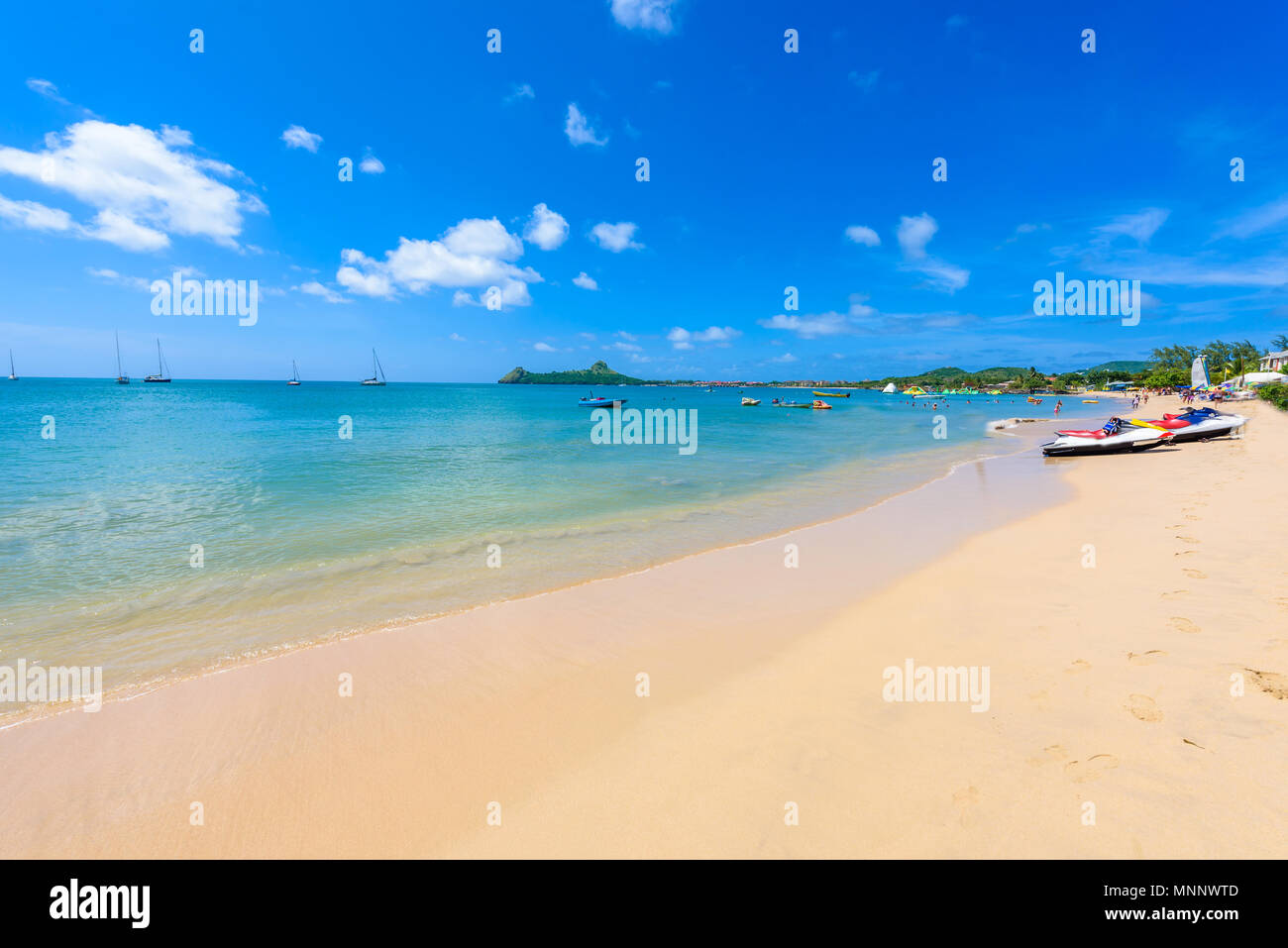 Reduit Beach - Tropical coast on the Caribbean island of St. Lucia. It is a paradise destination with a white sand beach and turquoiuse sea. - Stock Image