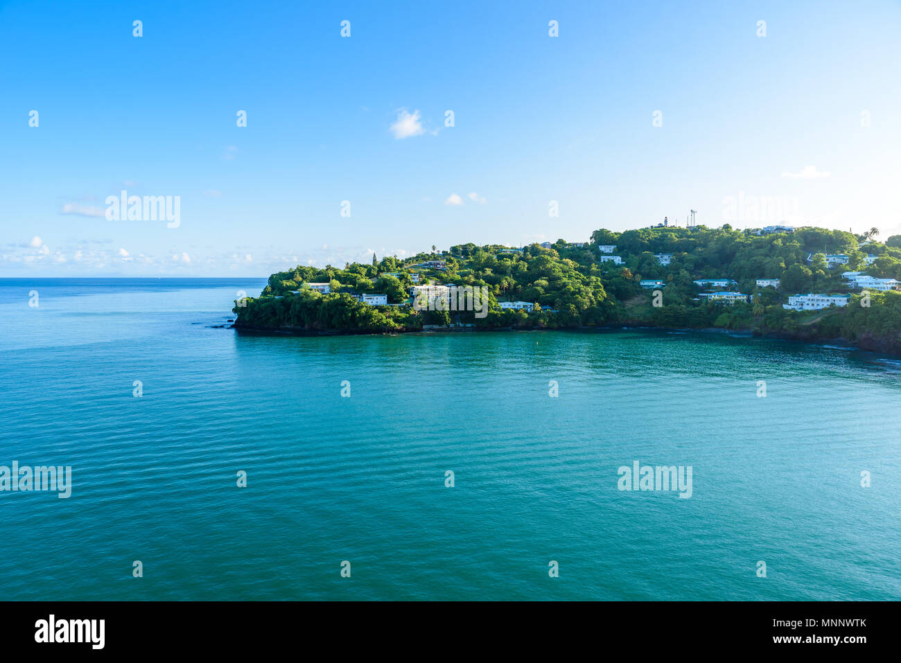 Tropical coast on the Caribbean island of St. Lucia. It is a paradise destination with a white sand beach and turquoiuse sea. - Stock Image