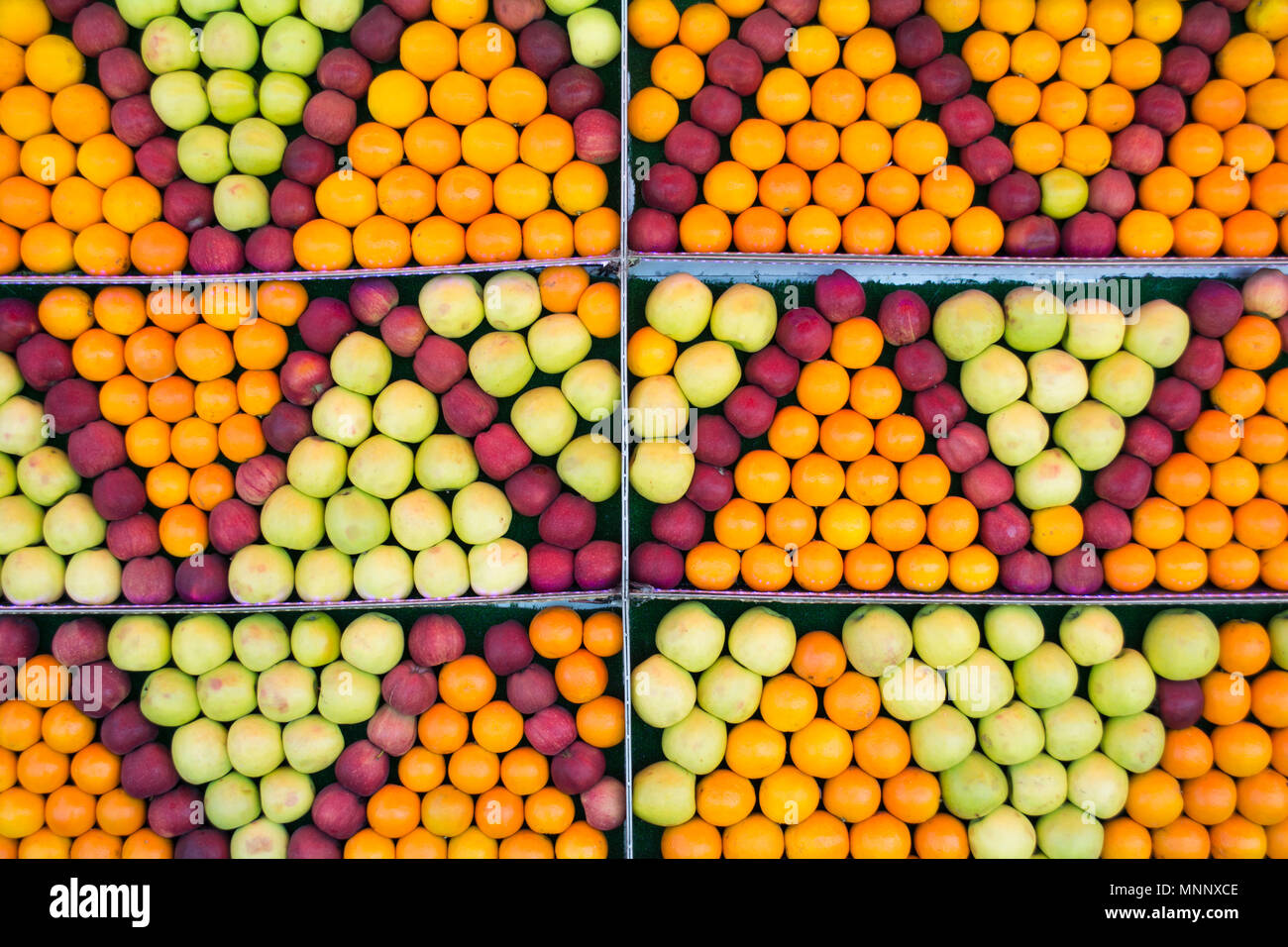 A mix of fresh Orange and green apple background - Stock Image