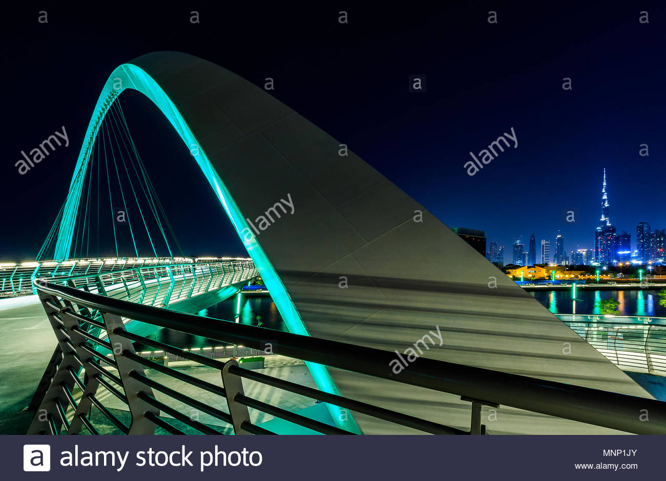 View of the Tolerance Bridge and Burj Khalifa from the Dubai Water Canal. - Stock Image