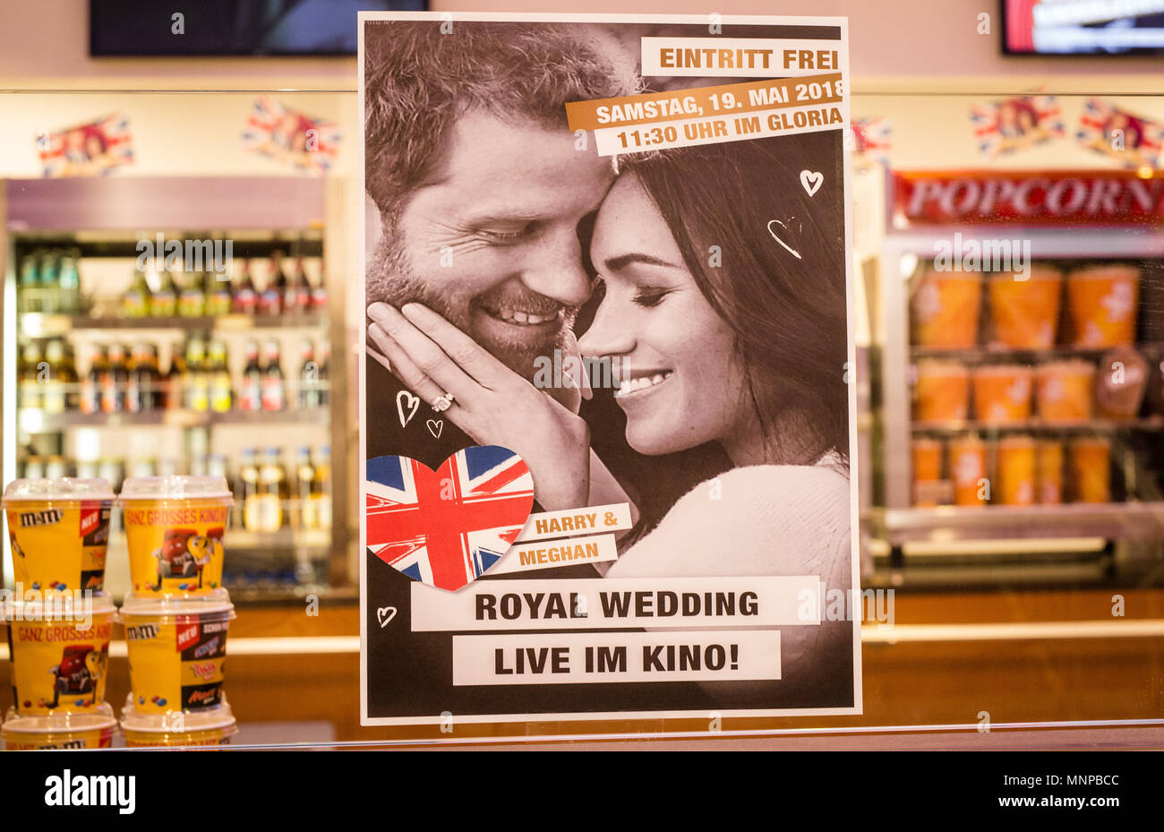 Stuttgart, Germany, 19 May 2018. An advertising poster informs cinema visitors about the royal wedding of Prince Harry and Meghan Markle, which they can watch for free at the Gloria cinema. Photo: Christoph Schmidt/dpa Credit: dpa picture alliance/Alamy Live News - Stock Image