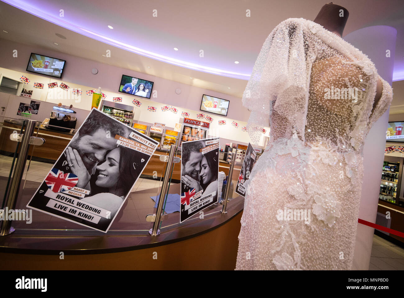 Stuttgart, Germany, 19 May 2018. Advertising posters inform cinema visitors about the royal wedding of Prince Harry and Meghan Markle, which they can watch for free at the Gloria cinema. Photo: Christoph Schmidt/dpa Credit: dpa picture alliance/Alamy Live News - Stock Image