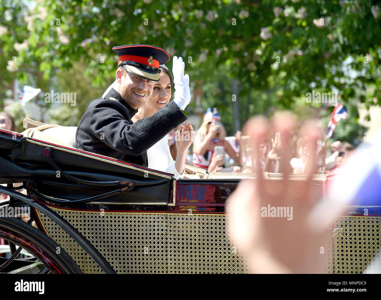 Windsor, UK. 19th May 2018. Meghan Markle and Prince Harry during the carriage procession on the Long Walk Credit: Finnbarr Webster/Alamy Live News Stock Photo