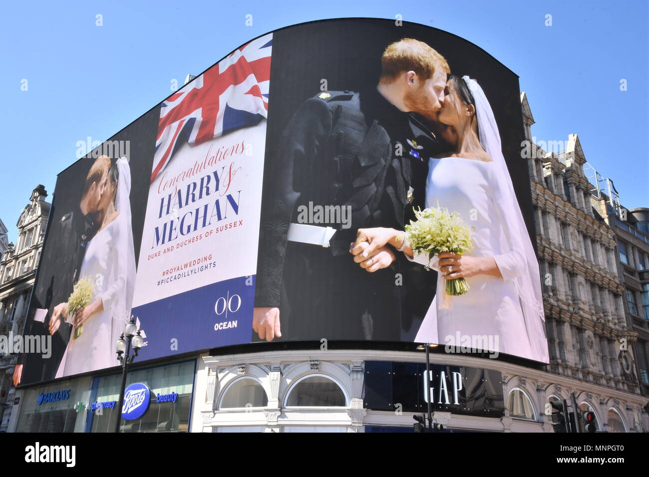 A picture of Prince Harry and Meghan Markle's Wedding in Windsor was displayed on the giant electronic billboard in Piccadilly Circus,London.UK Stock Photo