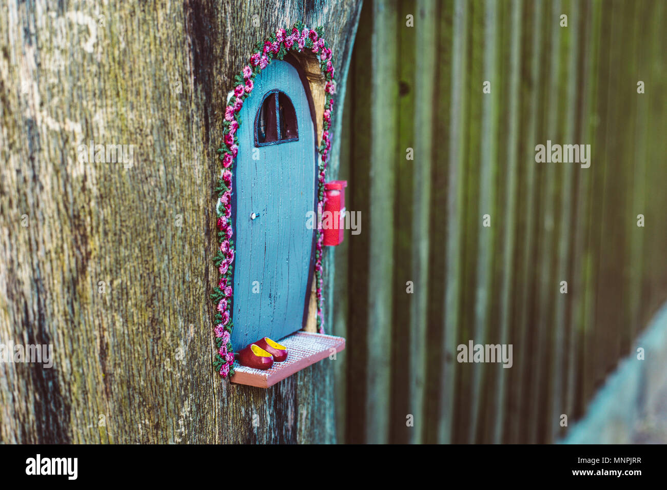 closeup photo of a tiny decorative house in the garden Stock Photo