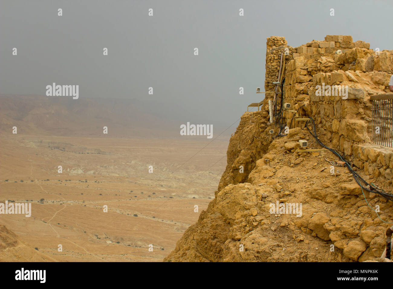 Some of the reconstructed ruins of the ancient Jewish clifftop fortress of Masada in Southern Israel.  This was the scene of an historic mass suicide. Stock Photo