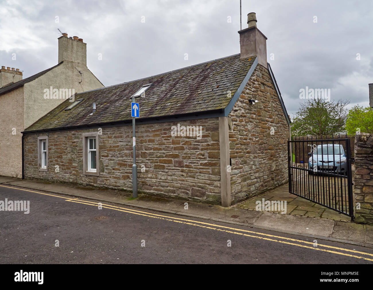 A well restored stone built, traditional Scottish terraced Cottage in Long Lane in Broughty Ferry, Dundee, Angus, Scotland. Stock Photo