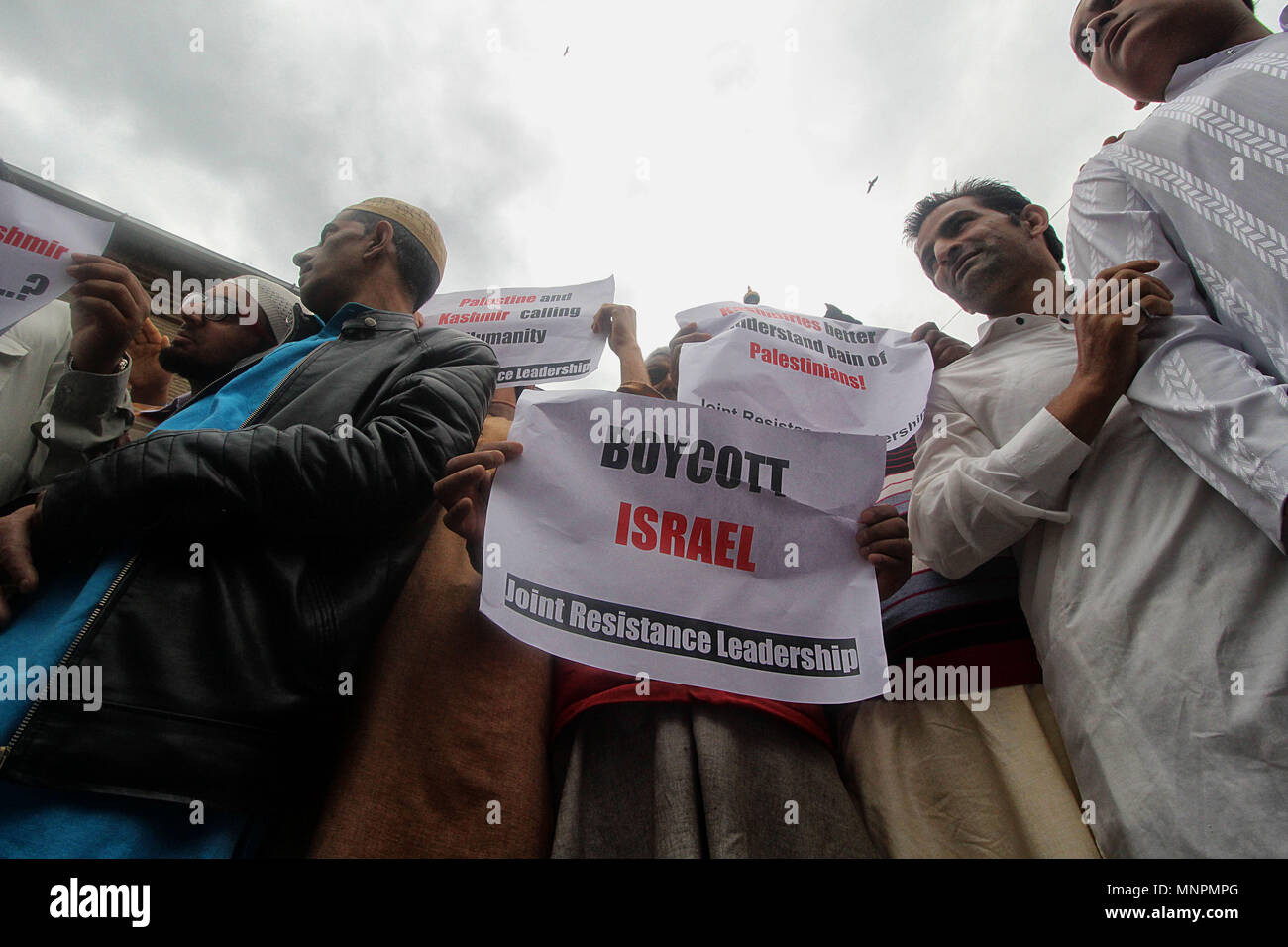 Activists and members of Joint Resistance Leadership (JRL) of Kashmir hold placards as they shout anti-Israel slogans during the protest in Srinagar the summer capital of Indian controlled Kashmir on May 18, 2018. More than 60 Palestinian protesters have been killed after Israeli forces opened fire on the Gaza border on May 14, who had assembled alongside the fence to protest against the moving of United State's embassy from Tel Aviv to Jerusalem. Credit: Faisal Khan/Pacific Press/Alamy Live News - Stock Image