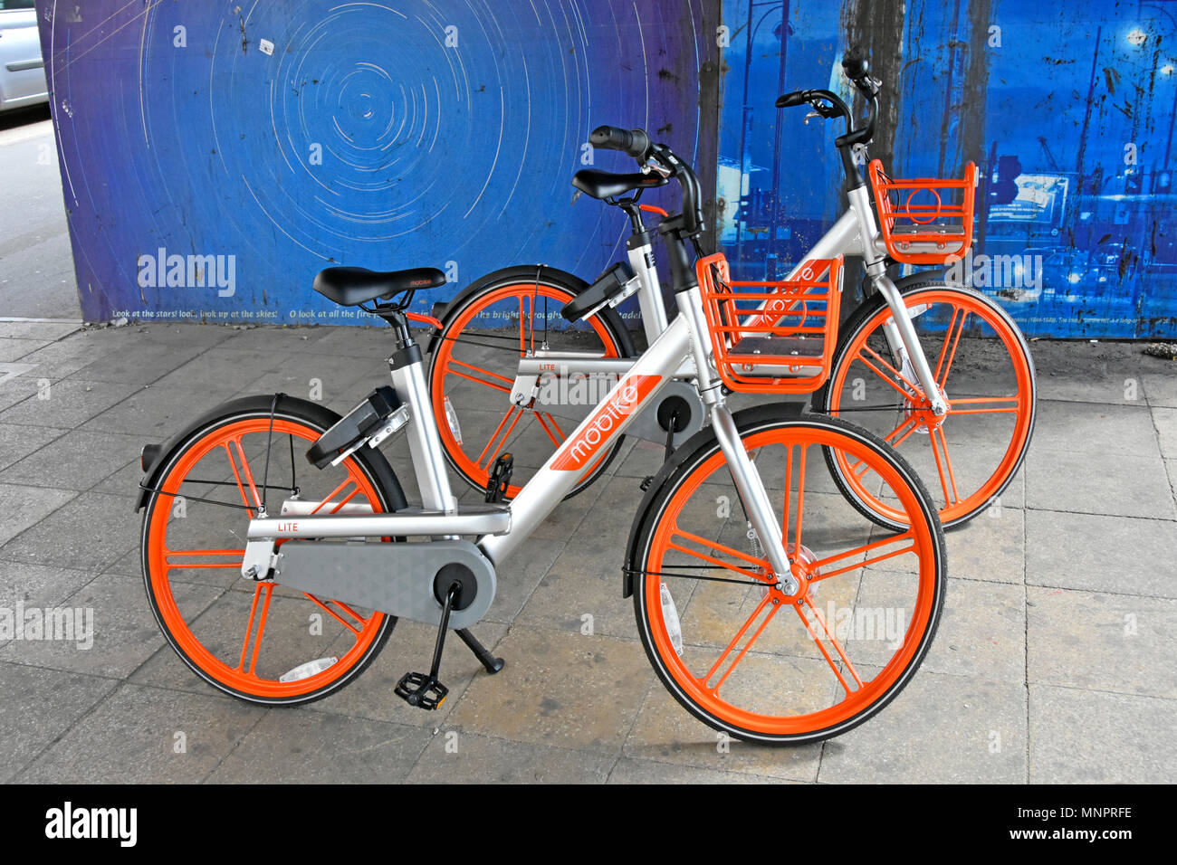 Smartphone App operated dockless Mobike Lite bike for hire from China based bicycle hiring business random parking awaiting reuse Stratford London UK - Stock Image