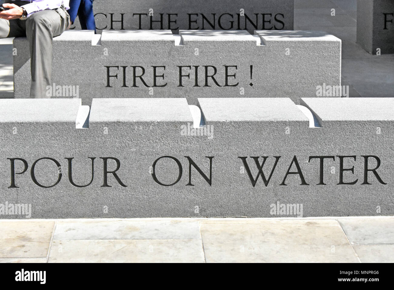 Granite stone bench seats at Monument Column inscribed words from Londons Burning childrens rhyme song poem about the Great Fire of London England UK - Stock Image