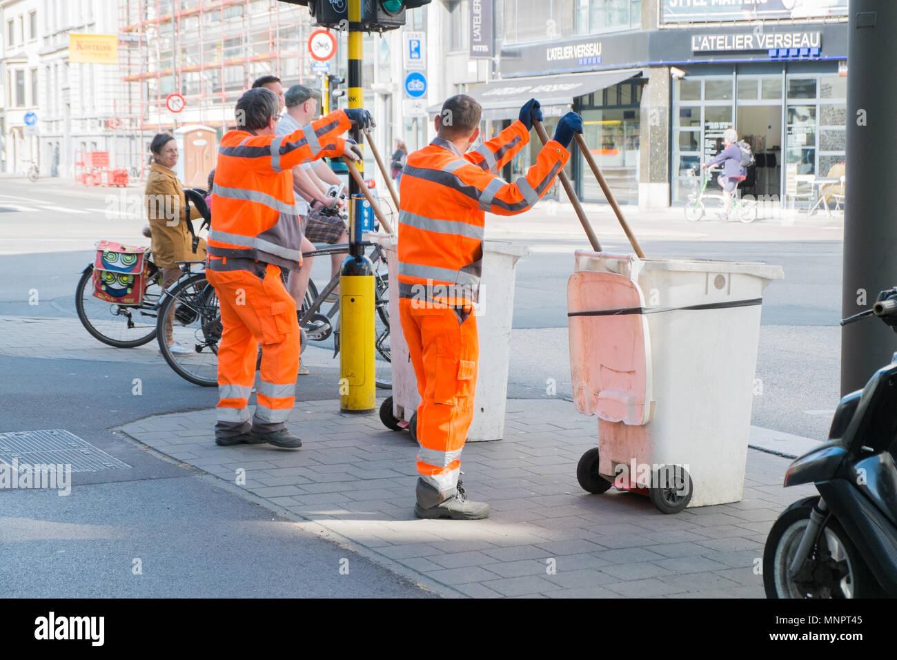 garbage collectors crossing street in antwerp, belgium Stock Photo