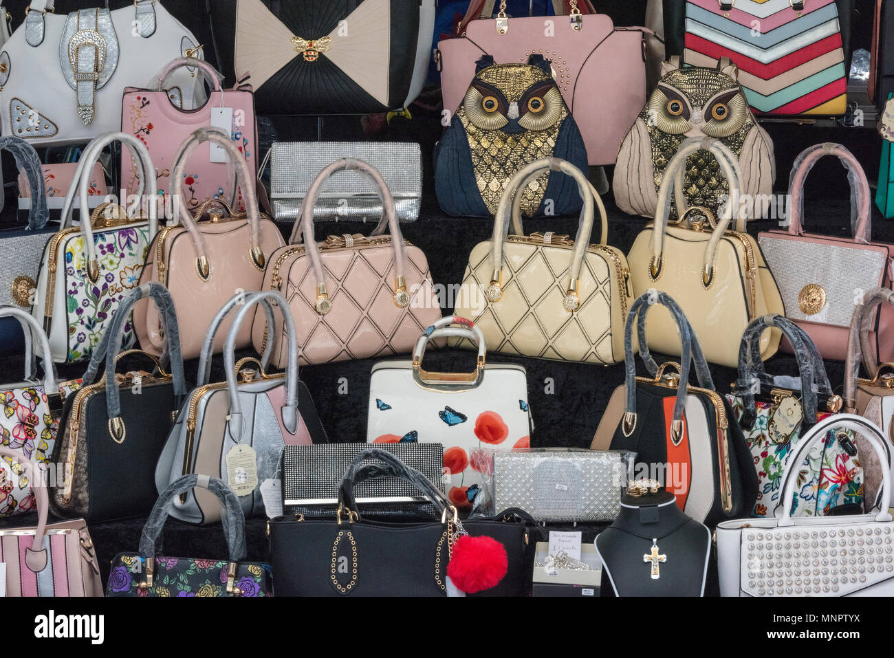 883d7432 a selection of designer handbags for sale on a market stall in a town  centre shopping