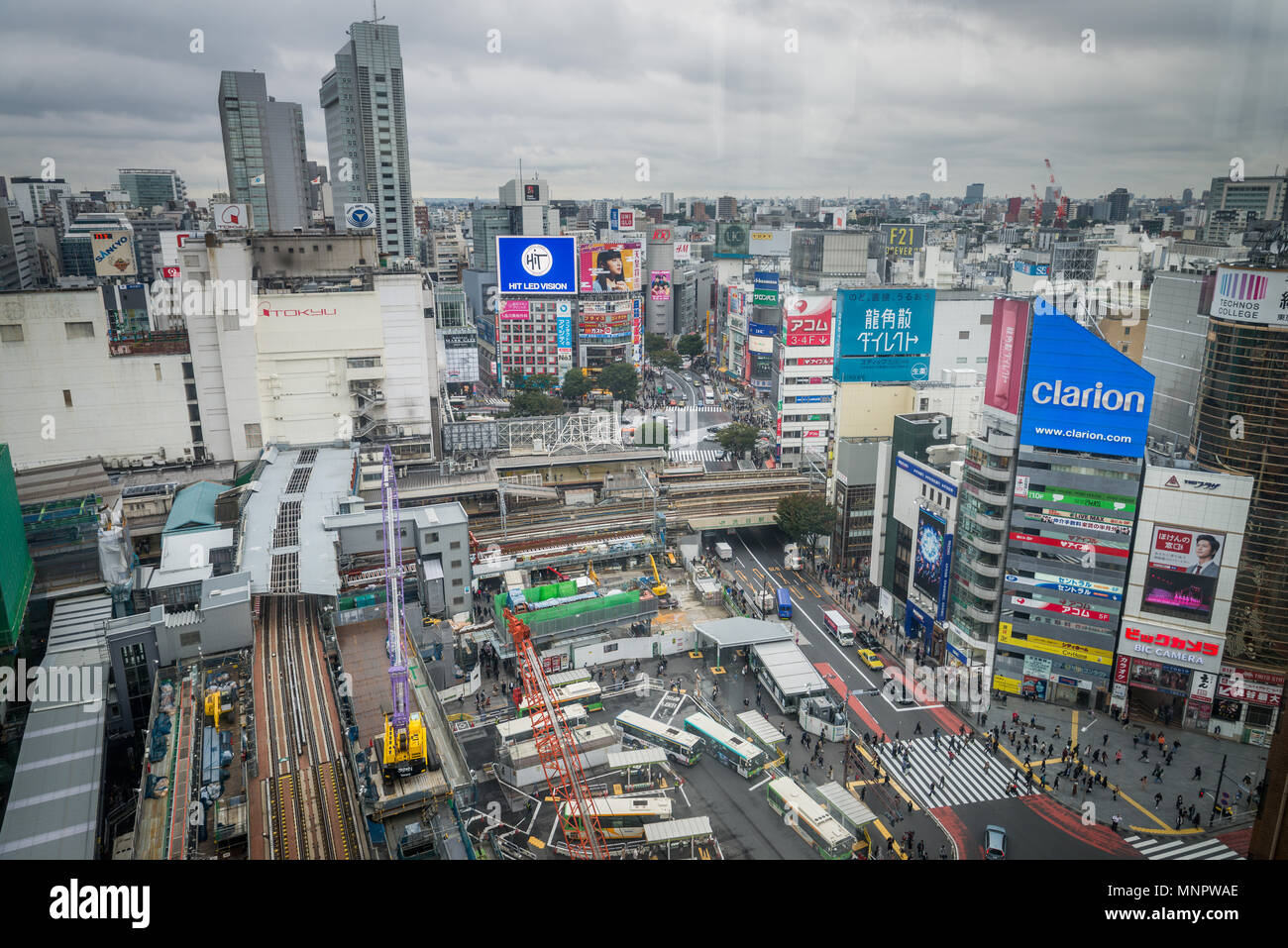 Tokyo, Japan - October 20, 2017: People and traffic at Shibuya Crossing. Scramble crossing in ShibuyaTokyo is famous landmark of Tokyo for nightlife a - Stock Image