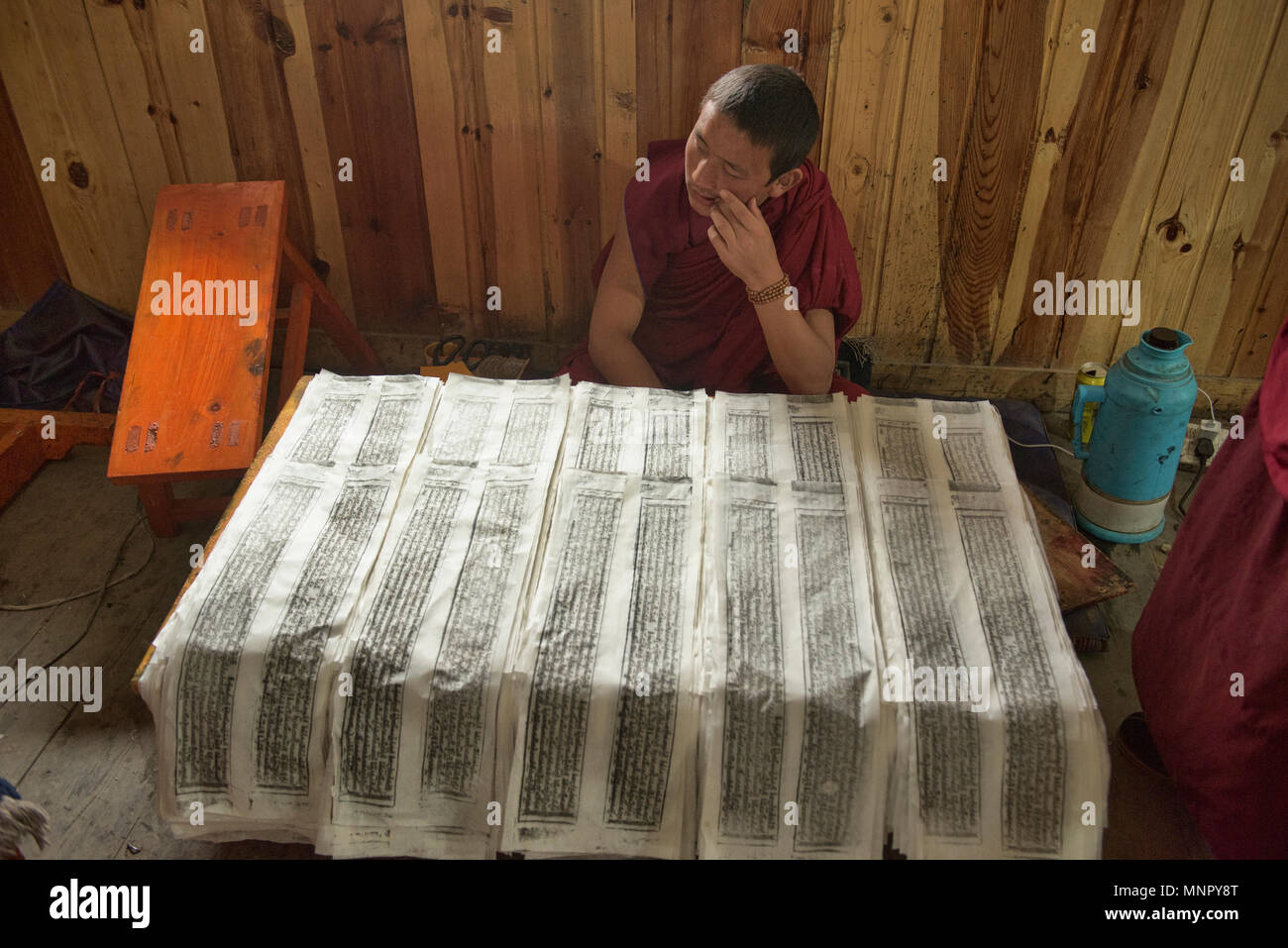 Monk Making Handmade Paper Scriptures And Woodblock Prints Inside The Holy Bakong Scripture Printing Press Monastery In Dege Sichuan China Stock Photo Alamy