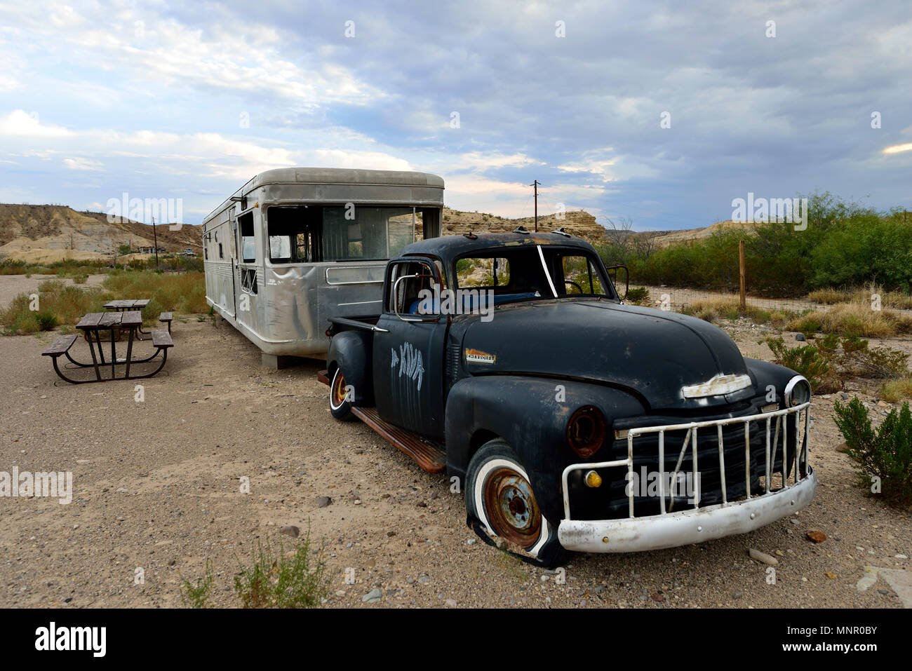 Old Rusty Chevrolet With Caravan At Rest Area Terlingua Texas Usa Stock Photo Alamy