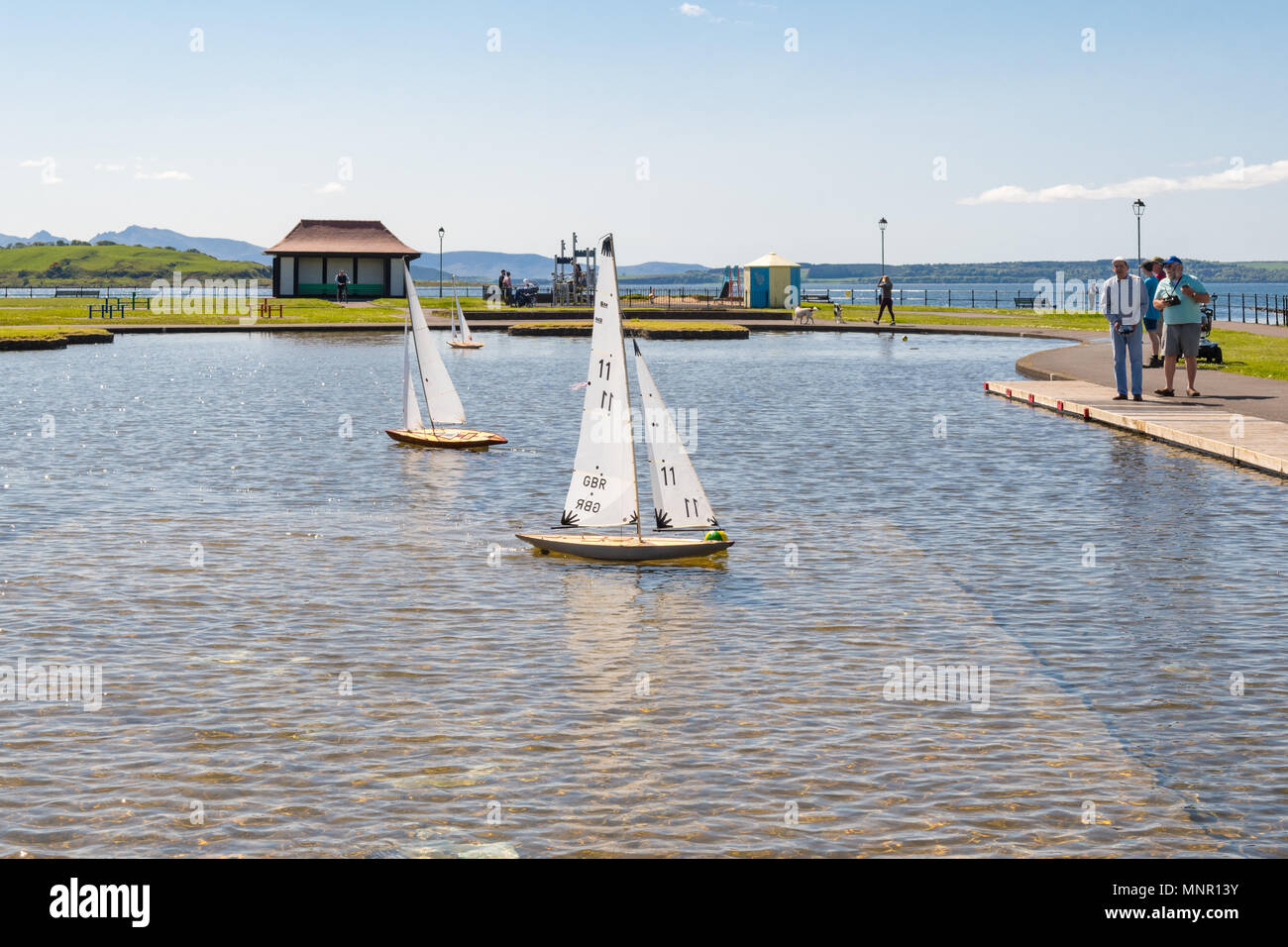 radio controlled vintage model yachts sailing on boating pond - Largs and District Model Boat Club, Largs, North Ayrshire, Scotland, UK - Stock Image