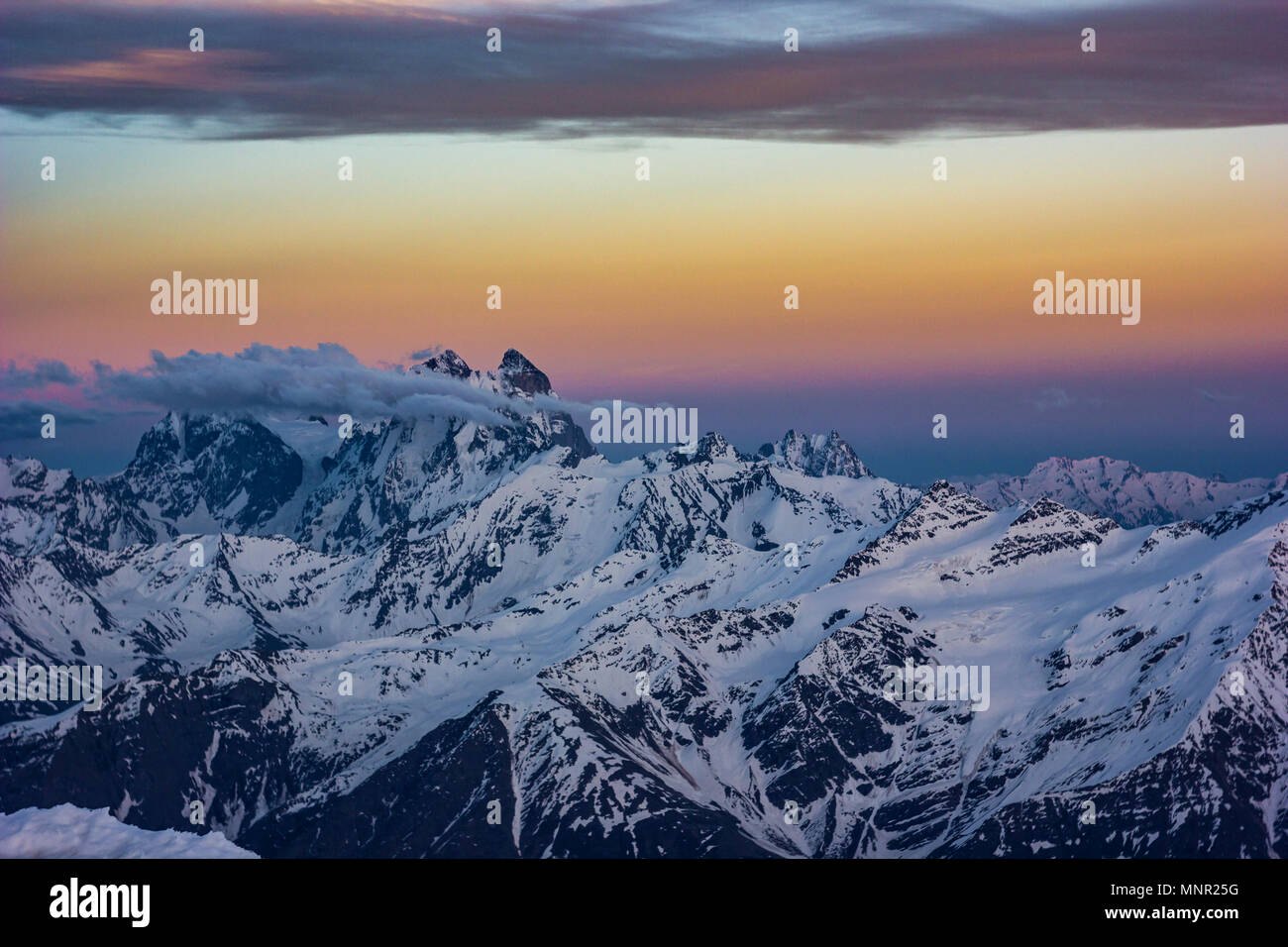 snowy Caucasus mountains at sunset - Stock Image