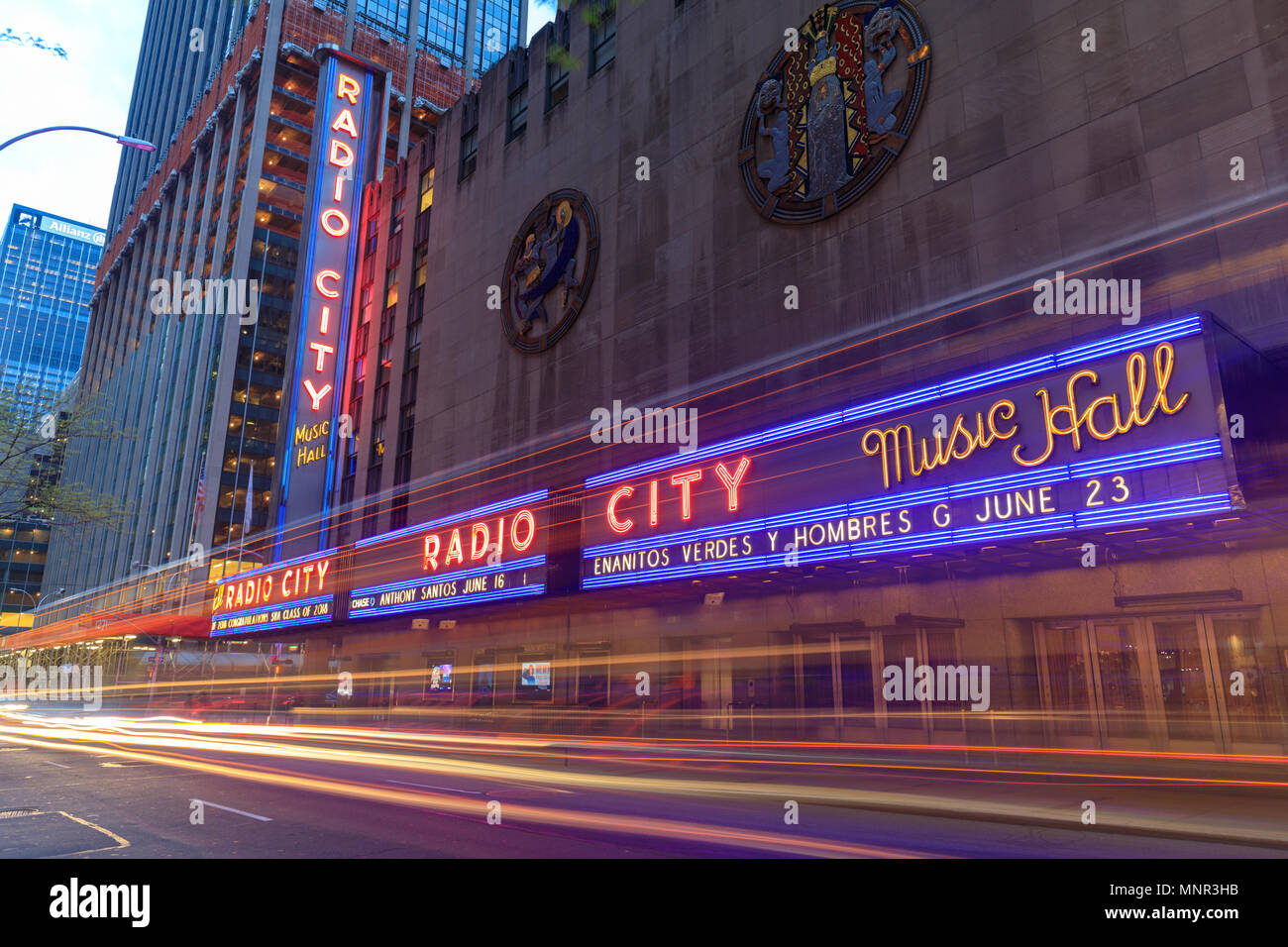 New York, USA - May 6, 2018 : Corner of Radio City Music Hall, theater building at Rockefeller Center, modern architecture with billboards. Entertainm - Stock Image