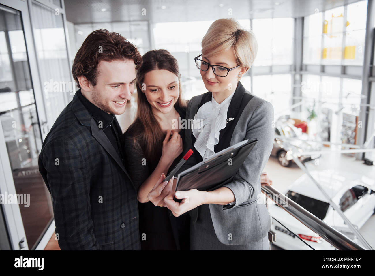 Group of young business people working together in big coworking office. Marketing department discussing product plan. New startup company - Stock Image